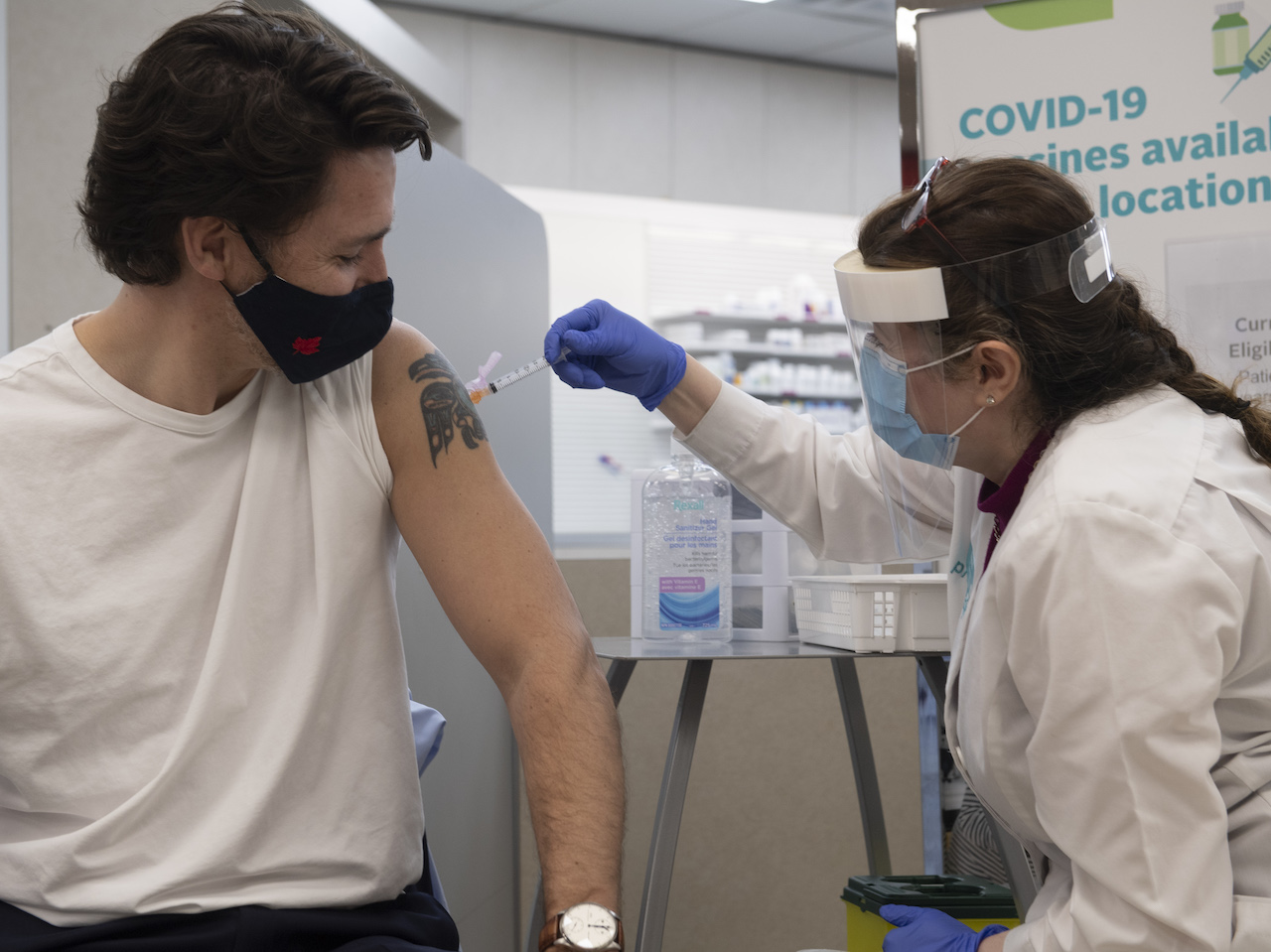 Justin Trudeau receives a dose of the AstraZeneca vaccine in an Ottawa pharmacy on Friday, April 23, 2021.