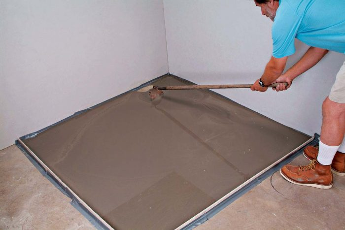 Use a long-handled hoe to help spread compound into the corners.