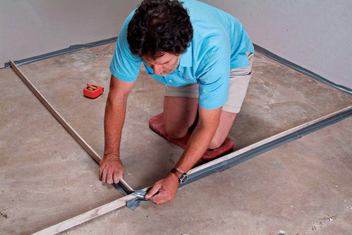 Tape wood strips together to use as dividers to separate areas.