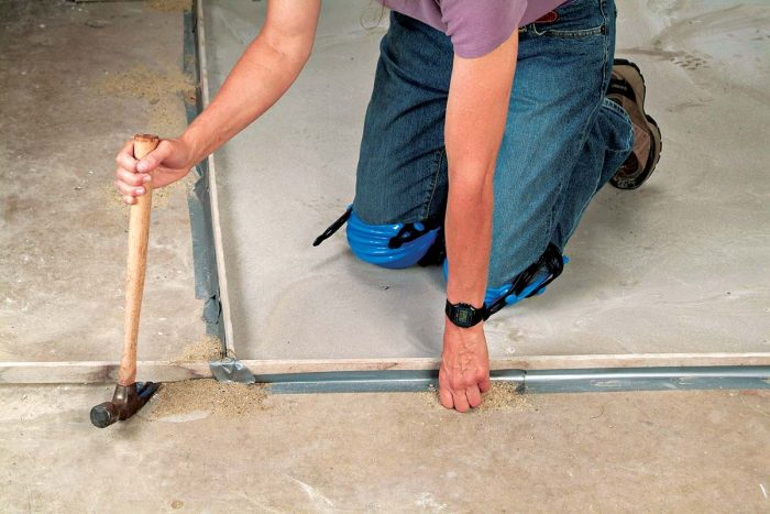 After the floor has dried, lift the wood strips with the claw end of a hammer.